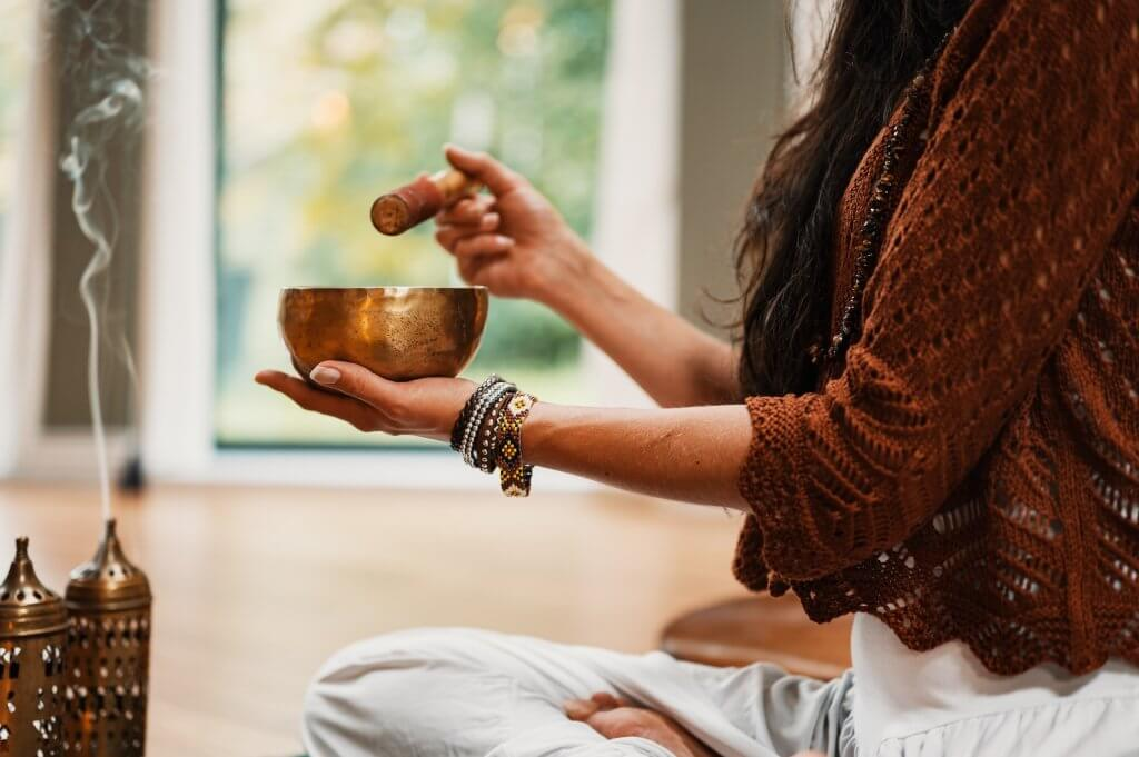 Woman preparing to meditate with incense