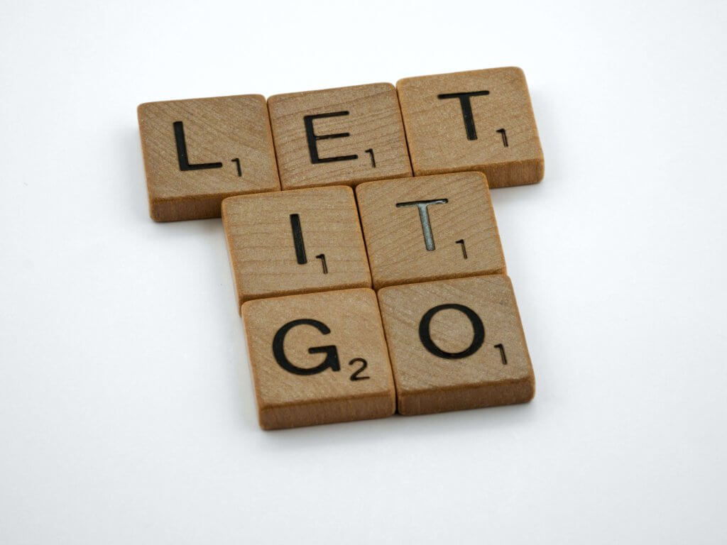 "Scrabble pieces placed to spell ""Let it go"""