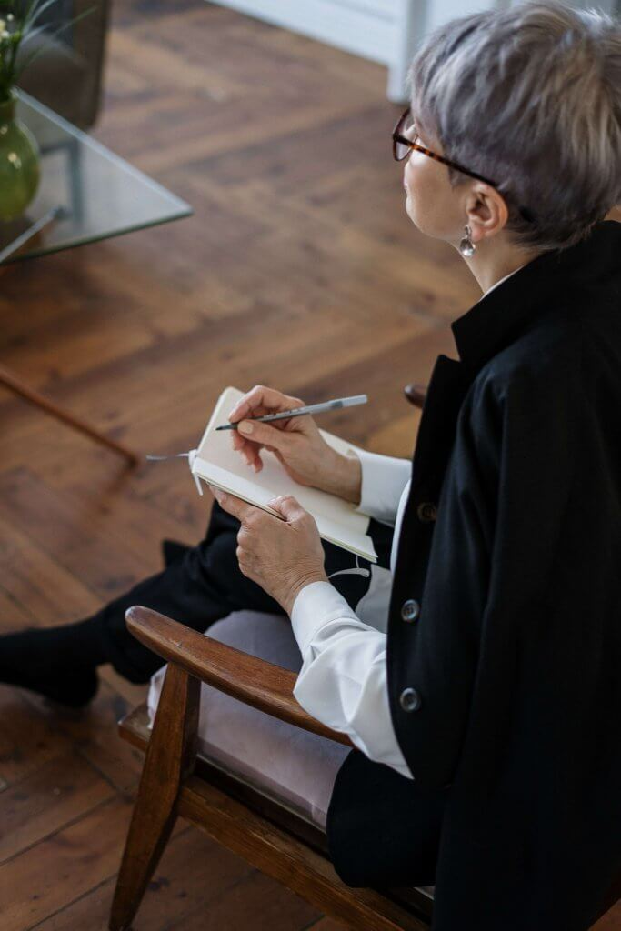 Schema Therapy - Psychologist taking notes during a therapy session