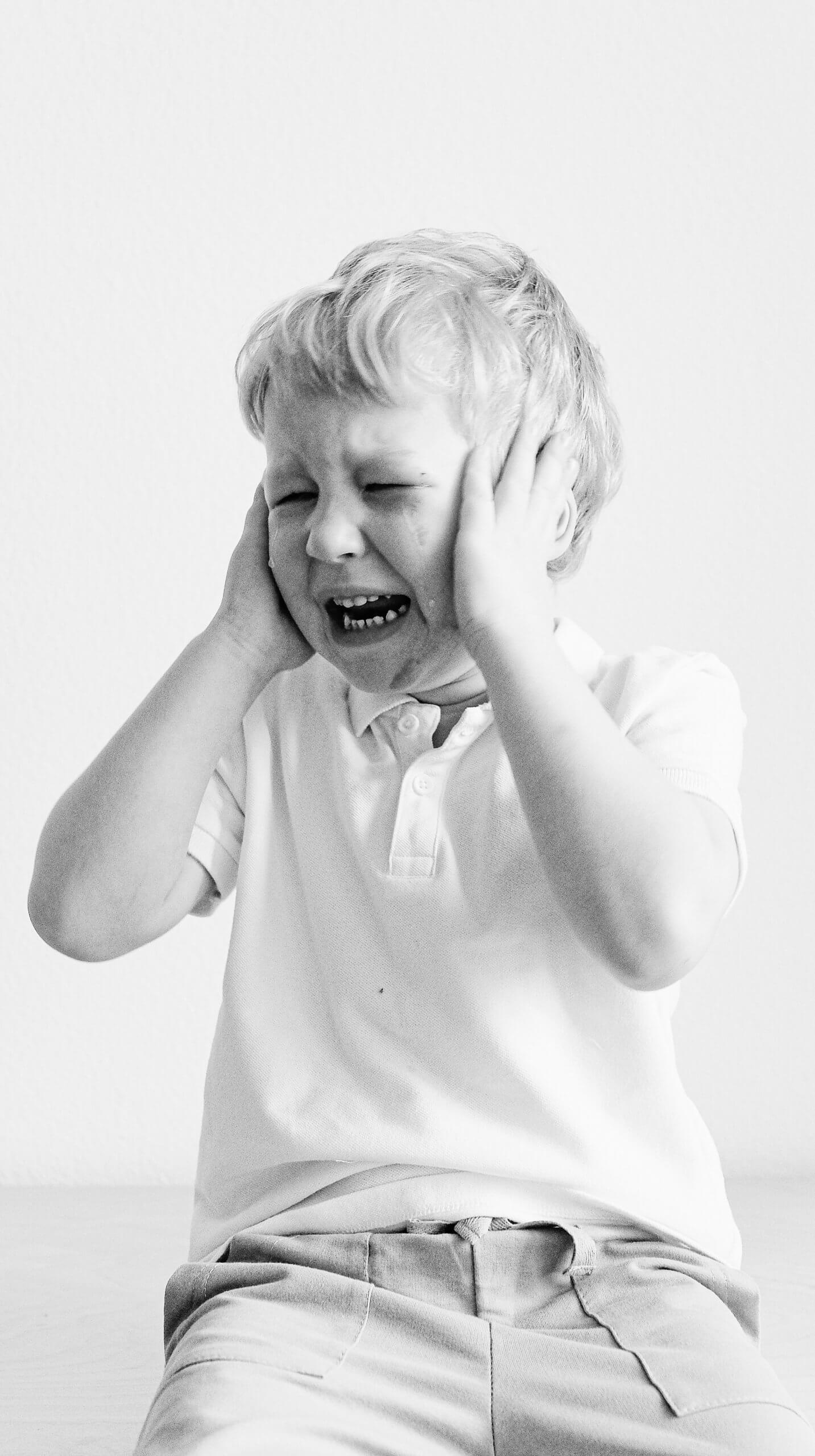 Disorganized Attachment - photo of young boy crying (self-regulation)