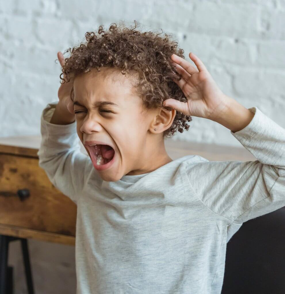 child exhibiting anxious ambivalent attachment - throwing a tantrum to maintain closeness with the caregiver