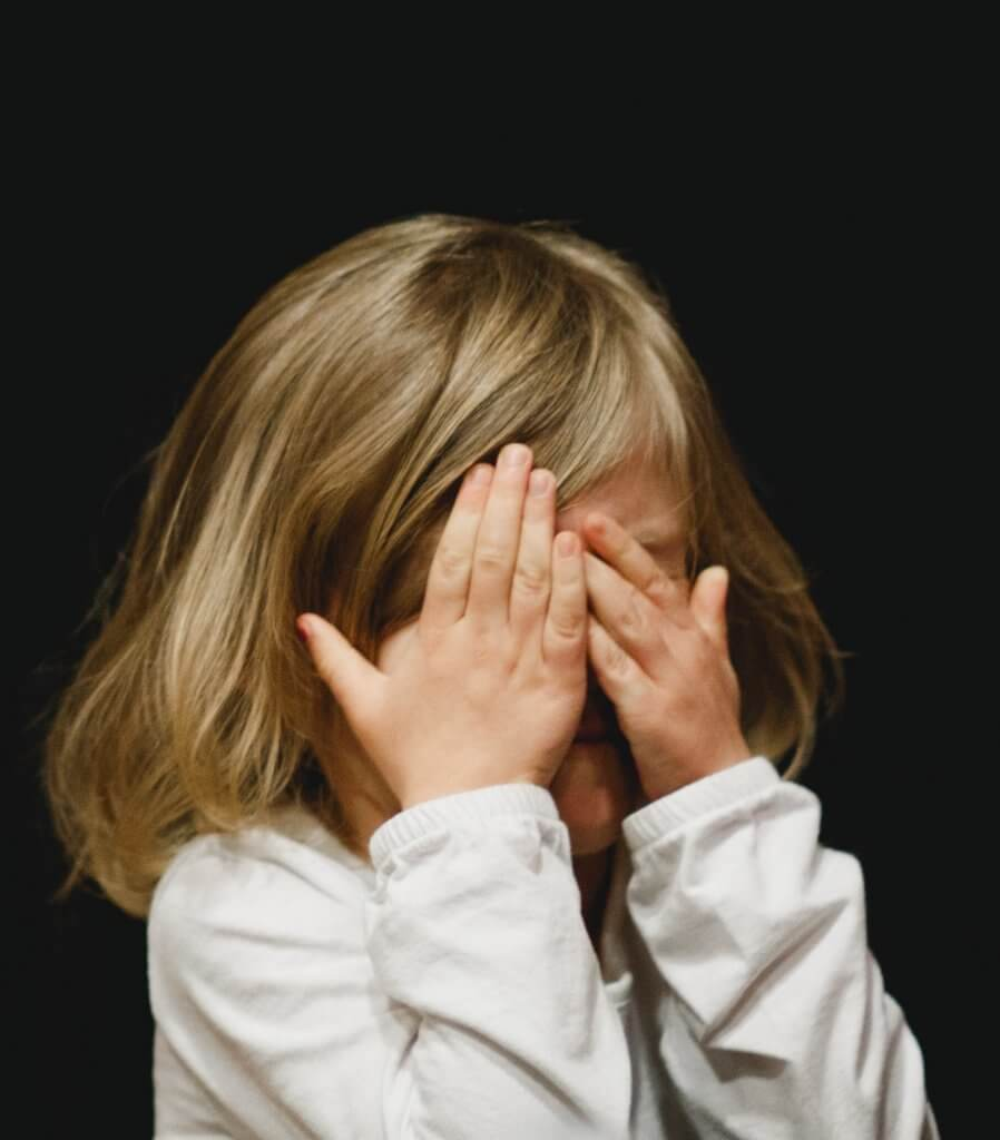 fearful avoidant attachment style - little girl afraid of making eye contact